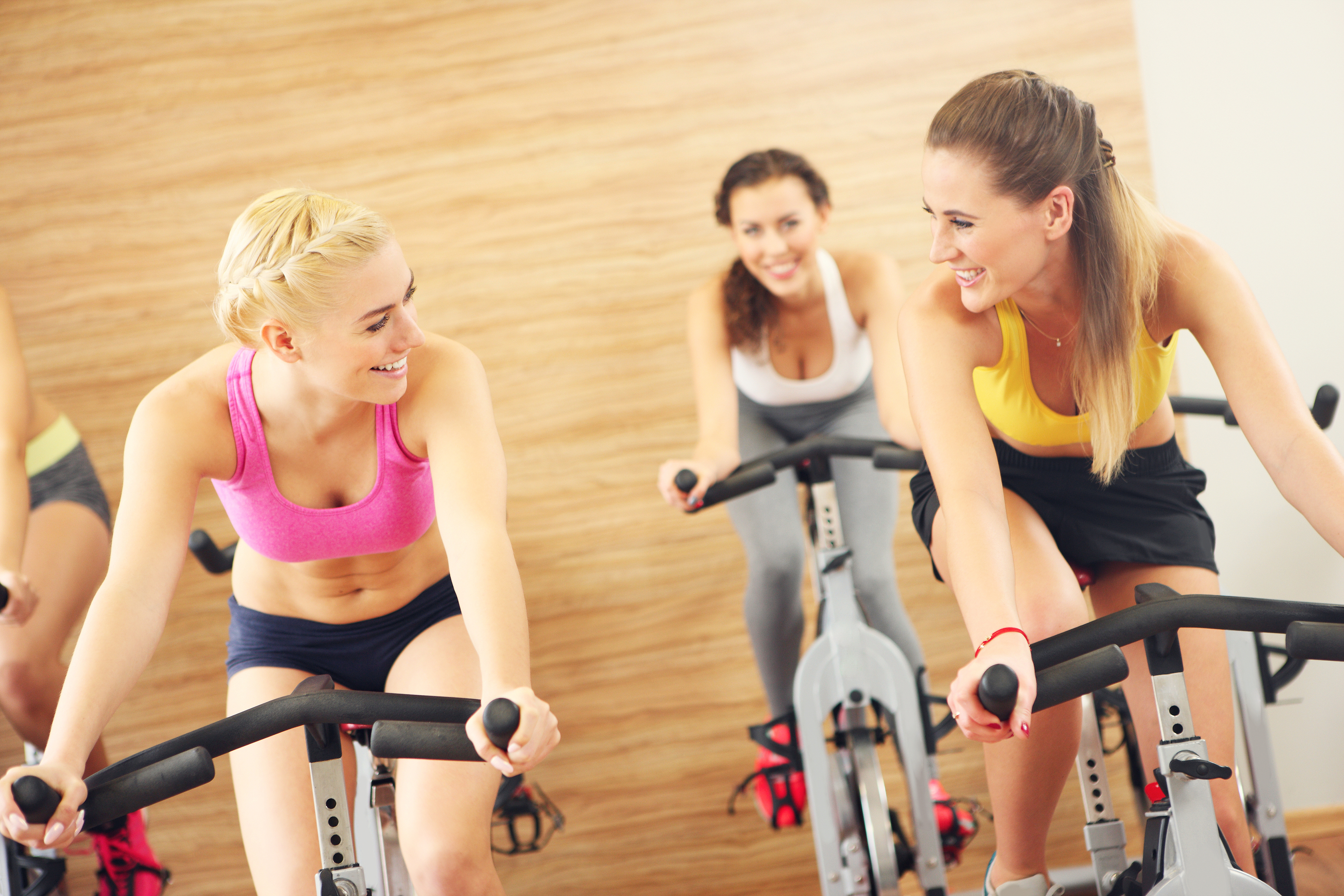 Group X Instructors Discussing Spin Class Ideas