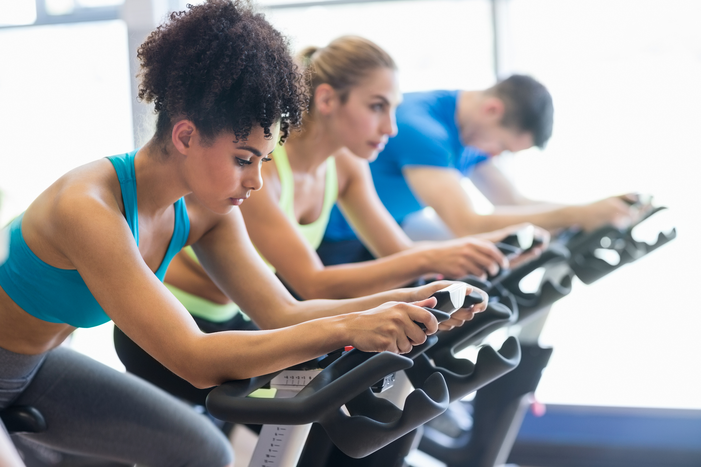 Folks doing interval training in a spin class