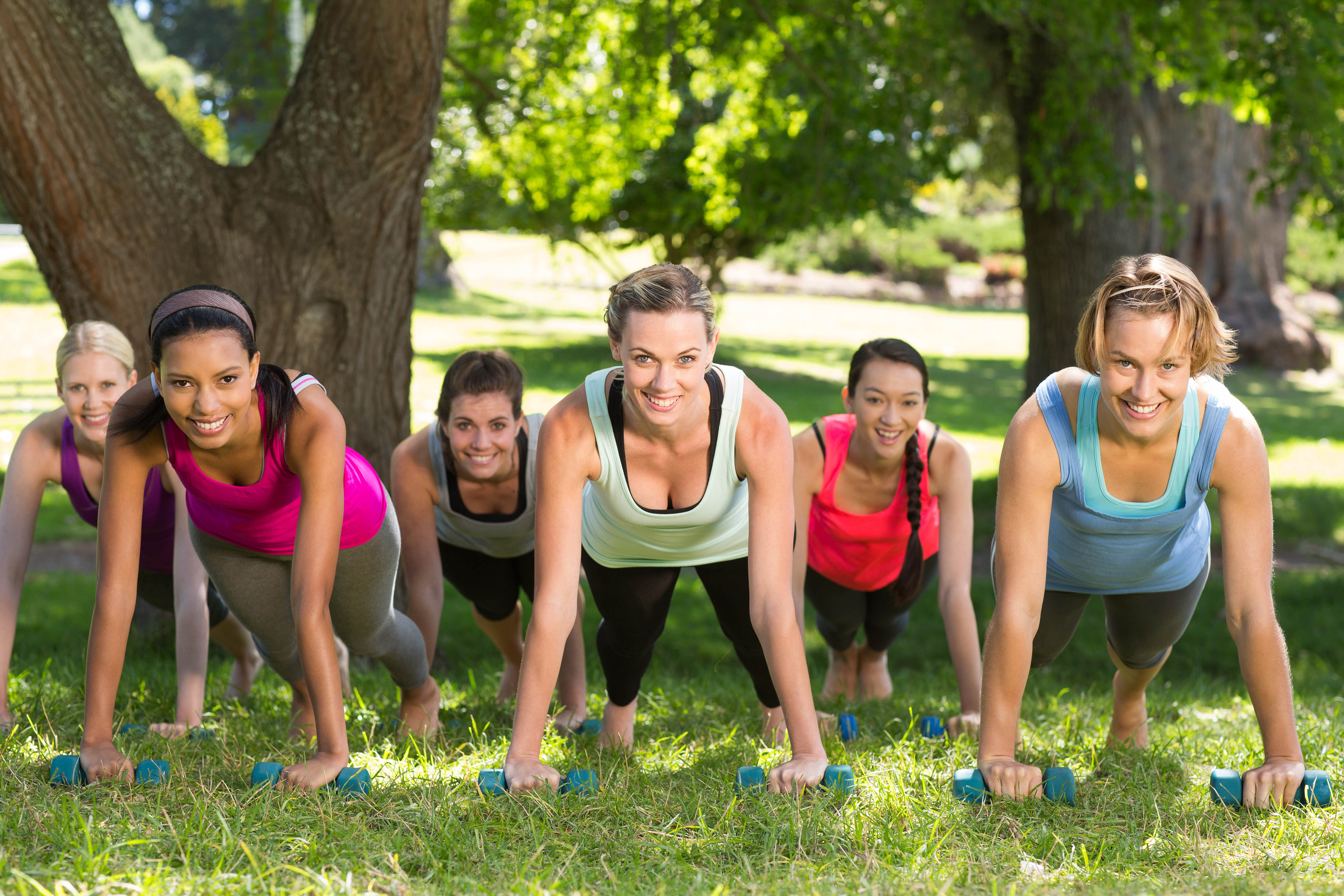 Outdoor group fitness class with a sub